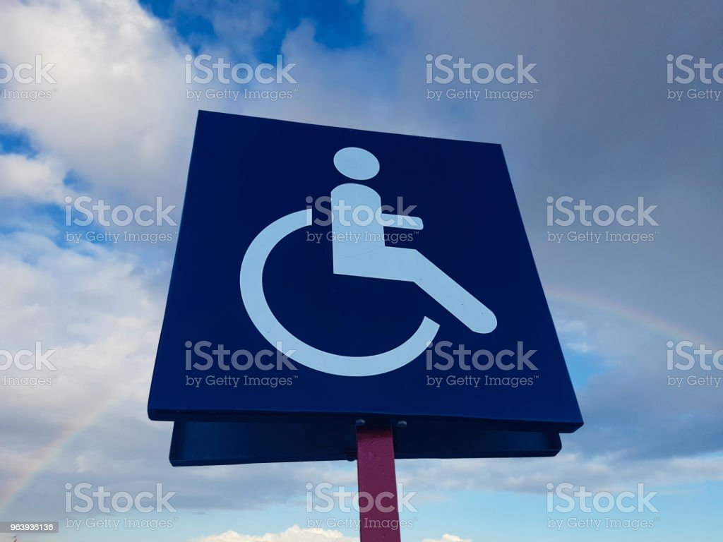 disability car parking sign to reserved space for handicap driver vehicle park - Royalty-free Accessibility Stock Photo
