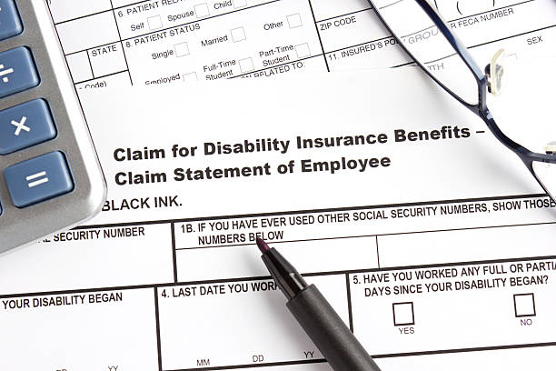 Disability insurance claim form stock photo