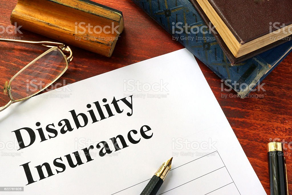 Disability insurance on a office table with a pen. stock photo