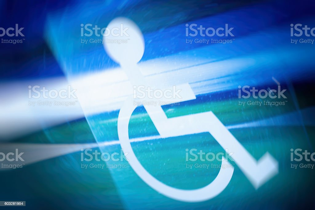 Disability sign, tram window stock photo