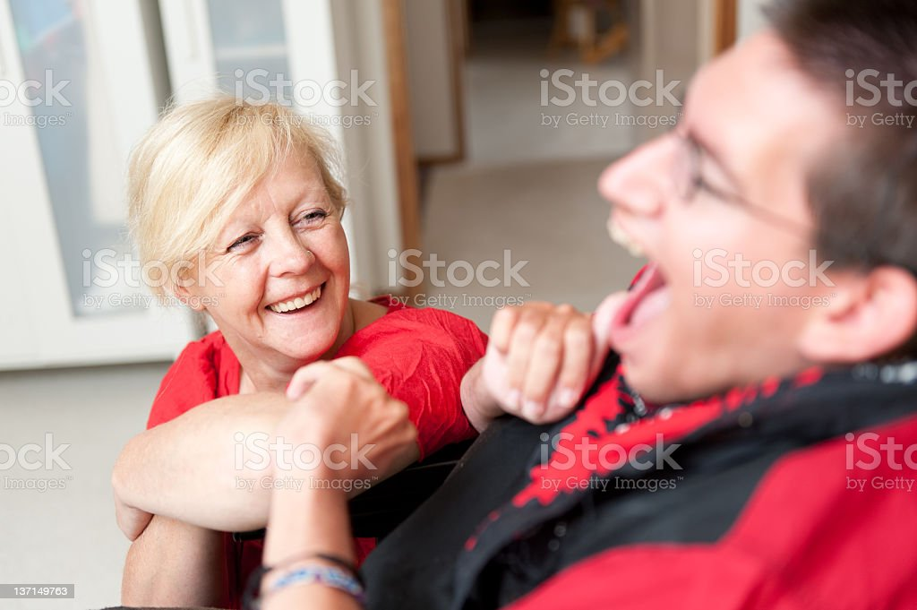 Disability Support Worker looking up at a Man stock photo