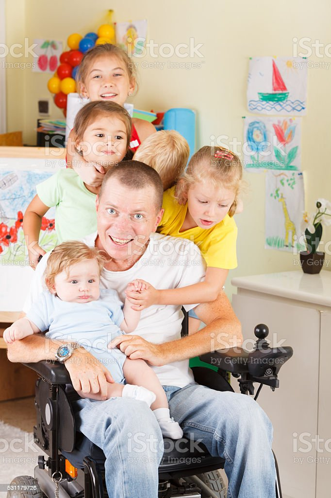 Disable dad play with children stock photo