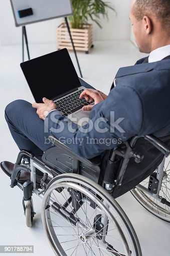 istock disabled african american businessman with laptop 901788794