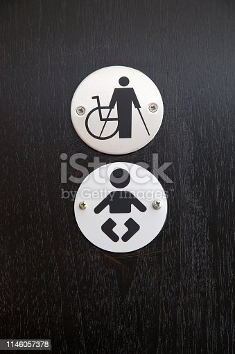 480193462 istock photo Disabled and Baby Changing Restroom Sign 1146057378