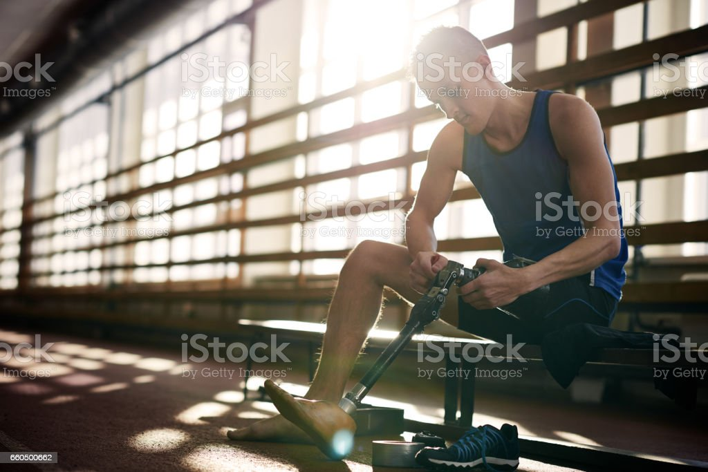 Disabled athlete preparing for training stock photo