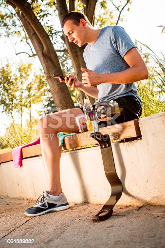 istock Disabled athlete resting after training 1064889882