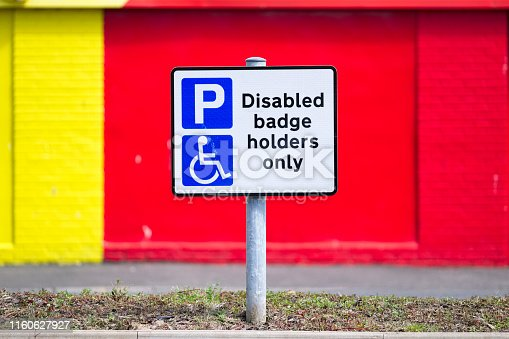 istock Disabled Badge Holders Only at Car Park Sign Post 1160627927