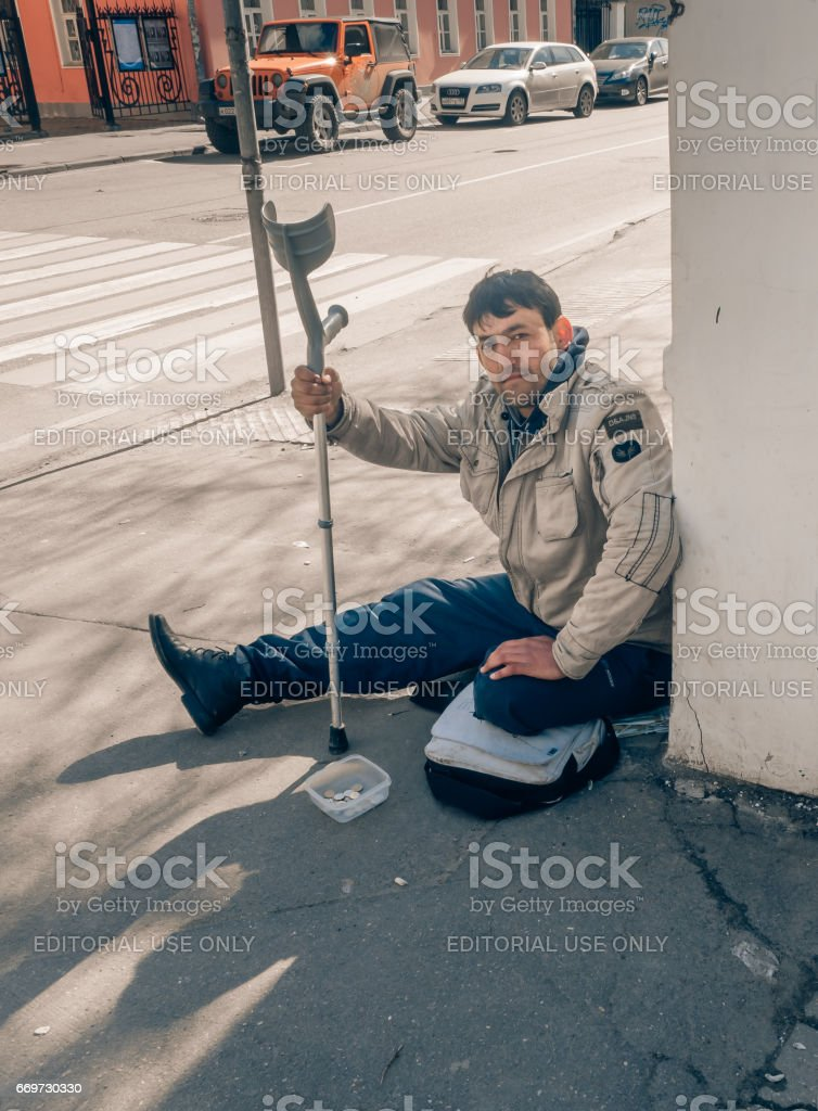 MOSCOW, RUSSIAN FEDERATION - APRIL 22: Disabled begging in the city and asks for alms. April 22, 2016, Novokuznetskaya street, Moscow, Russia . stock photo