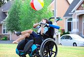 istock Disabled boy hitting ball with bat at park 519995441