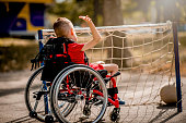 istock Disabled boy playing with sports ball 1273353637