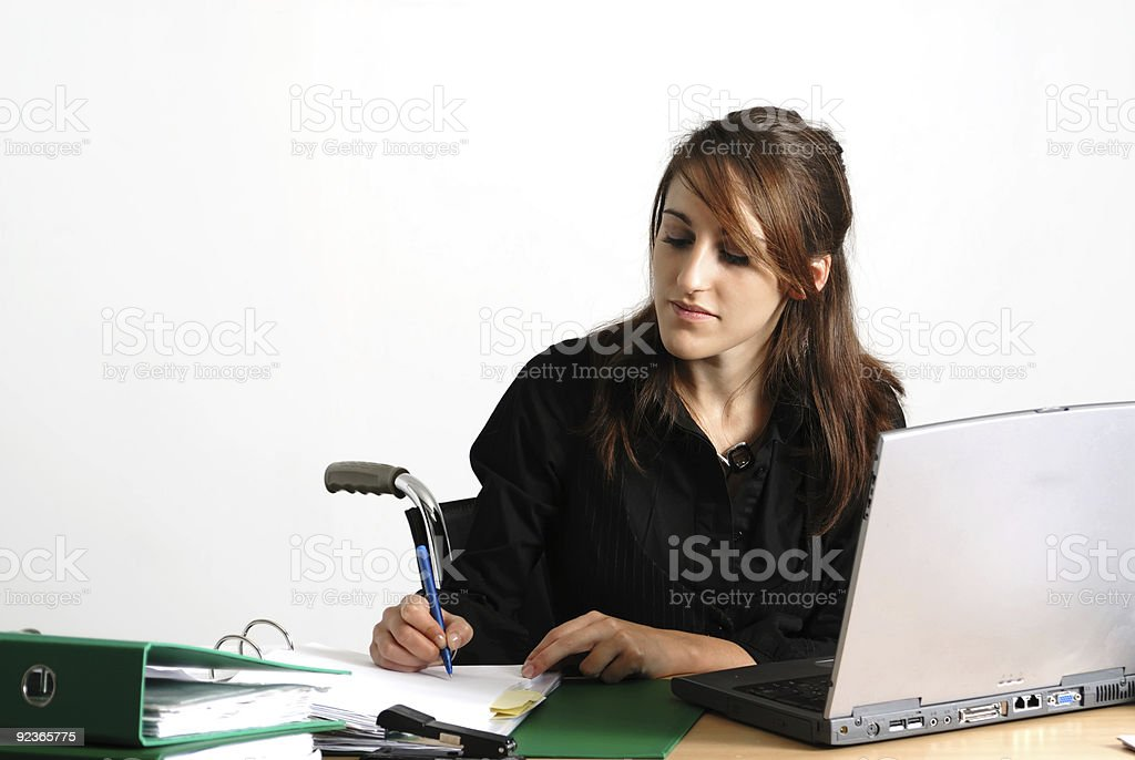 Disabled business woman at her desk royalty-free stock photo