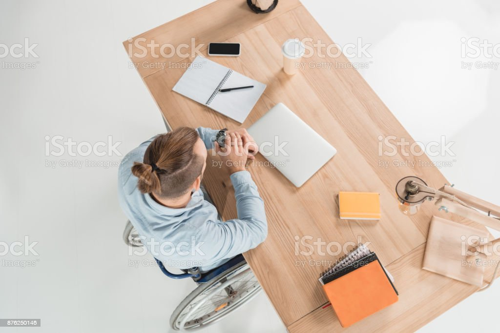 disabled businessman looking at watch stock photo