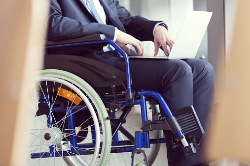 Disabled Businessman Sitting In A Wheelchair Stock Photo - Download Image Now