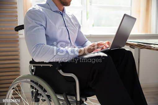 1144373653 istock photo Disabled Businessman Using Laptop 975124474