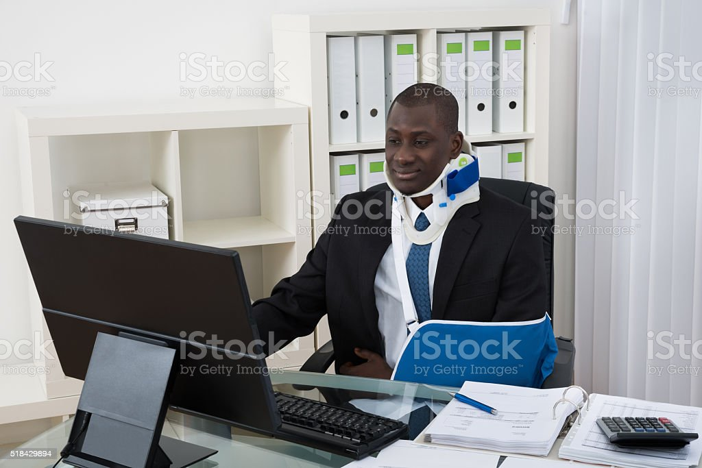 Disabled Businessman Working In Office stock photo