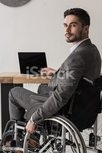 istock disabled businessman working in office 901792498