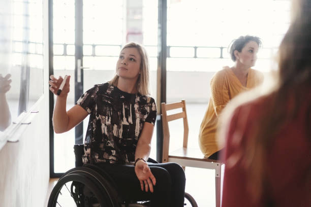 Disabled businesswoman giving presentation stock photo