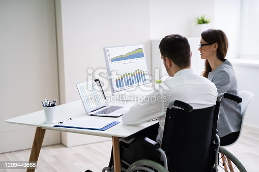 1144373653 istock photo Disabled Businesswoman Sitting With Her Partner In Office 1209449868