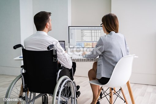 1144373653 istock photo Disabled Businesswoman Sitting With Her Partner In Office 1209449876