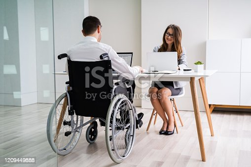 1144373653 istock photo Disabled Businesswoman Sitting With Her Partner In Office 1209449888
