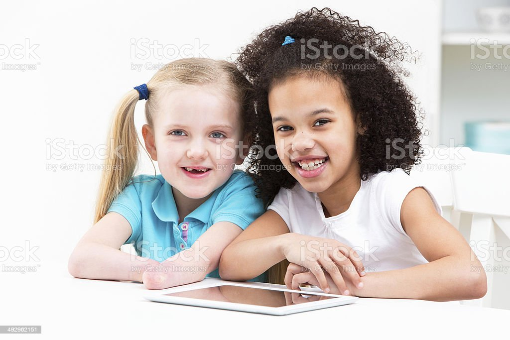 Disabled Child With Friend Using Digital Tablet At Home royalty-free stock photo