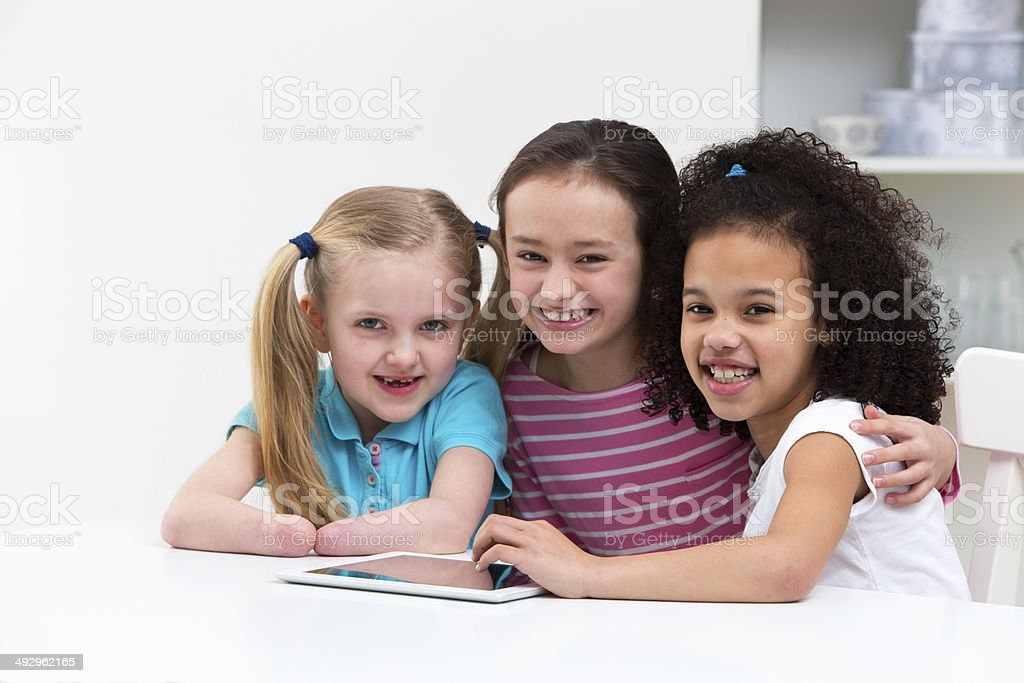 Disabled Child With Friends Using Digital Tablet At Home royalty-free stock photo