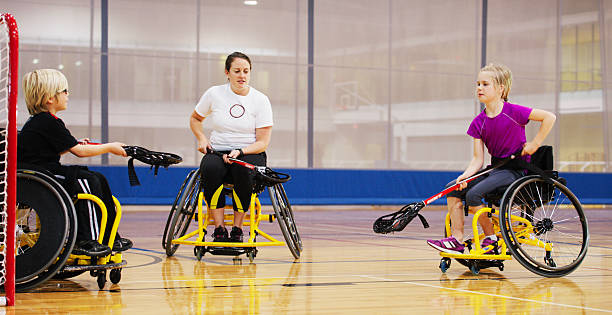 disabled children being coached at the gym - wheelchair sports stock photos and pictures