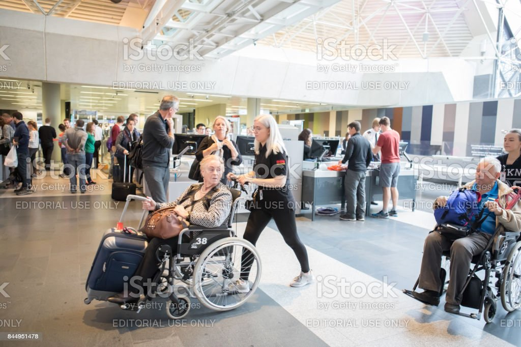 Disabled elderly passengers at TSA security checkpoint at Keflavik International Airport, Iceland stock photo