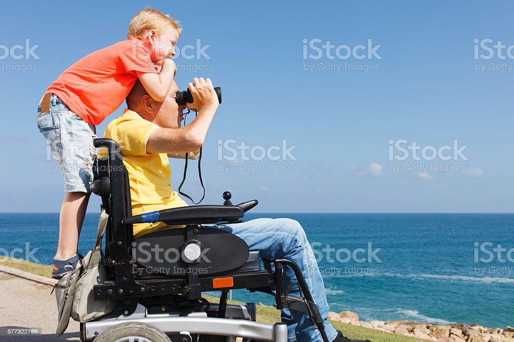 Disabled father and son play with Binocular – Foto