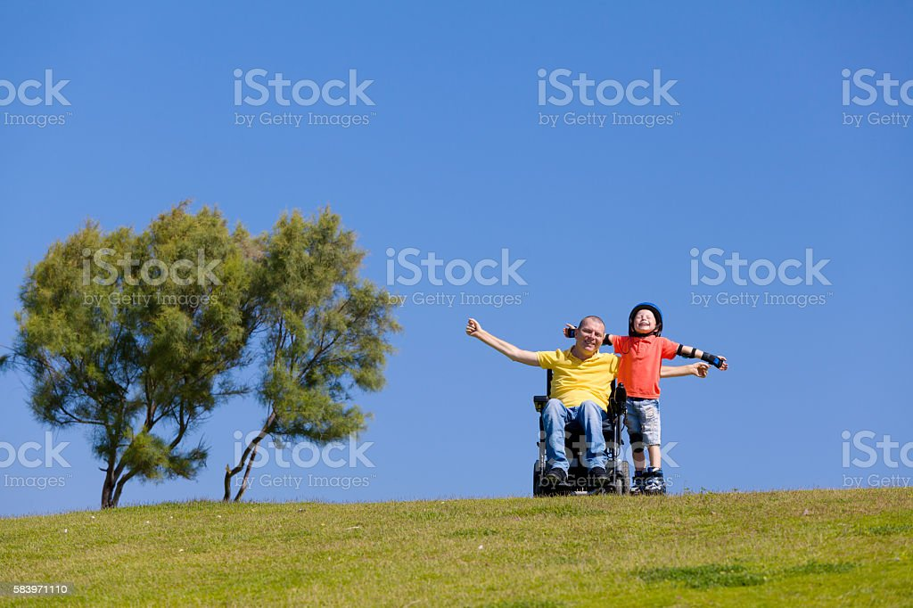Disabled Father play with his little son - foto de stock