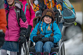 istock Disabled Girl Being Pushed in Her Wheelchair 507720082