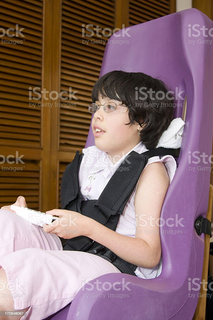 disabled girl in special seating royalty-free stock photo