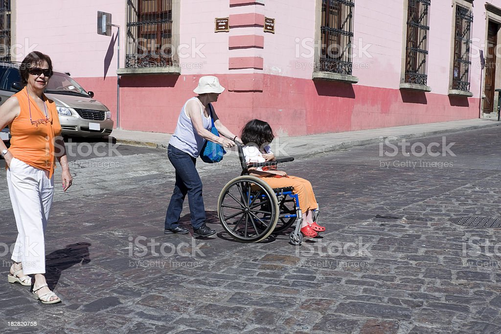 disabled girl in the street stock photo