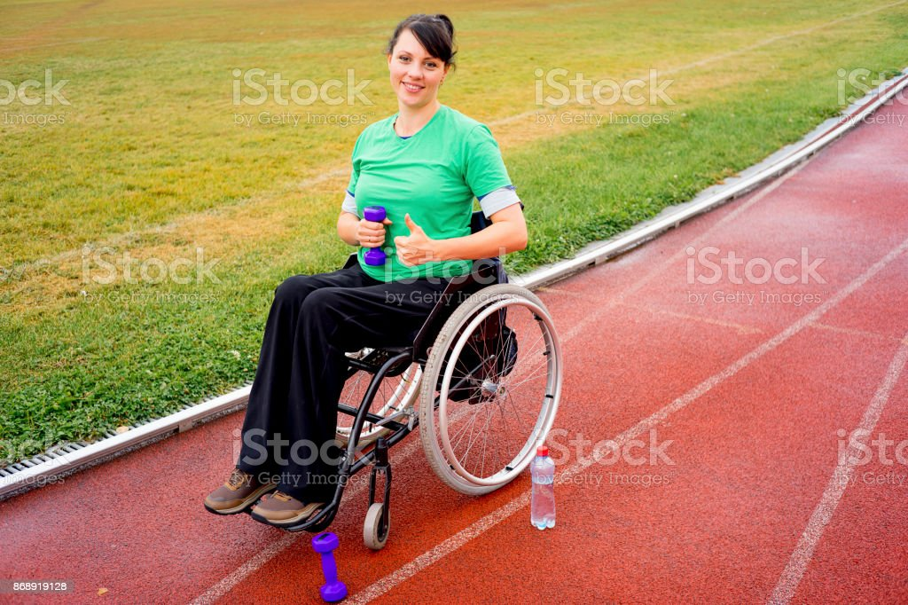 Disabled girl on a stadium stock photo