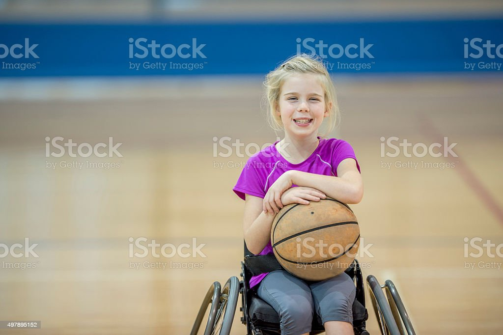 Disabled Girl Playing Basketball stock photo