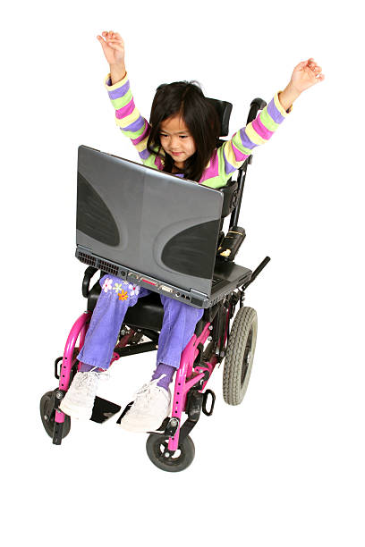 Disabled girl with arms in the air stock photo