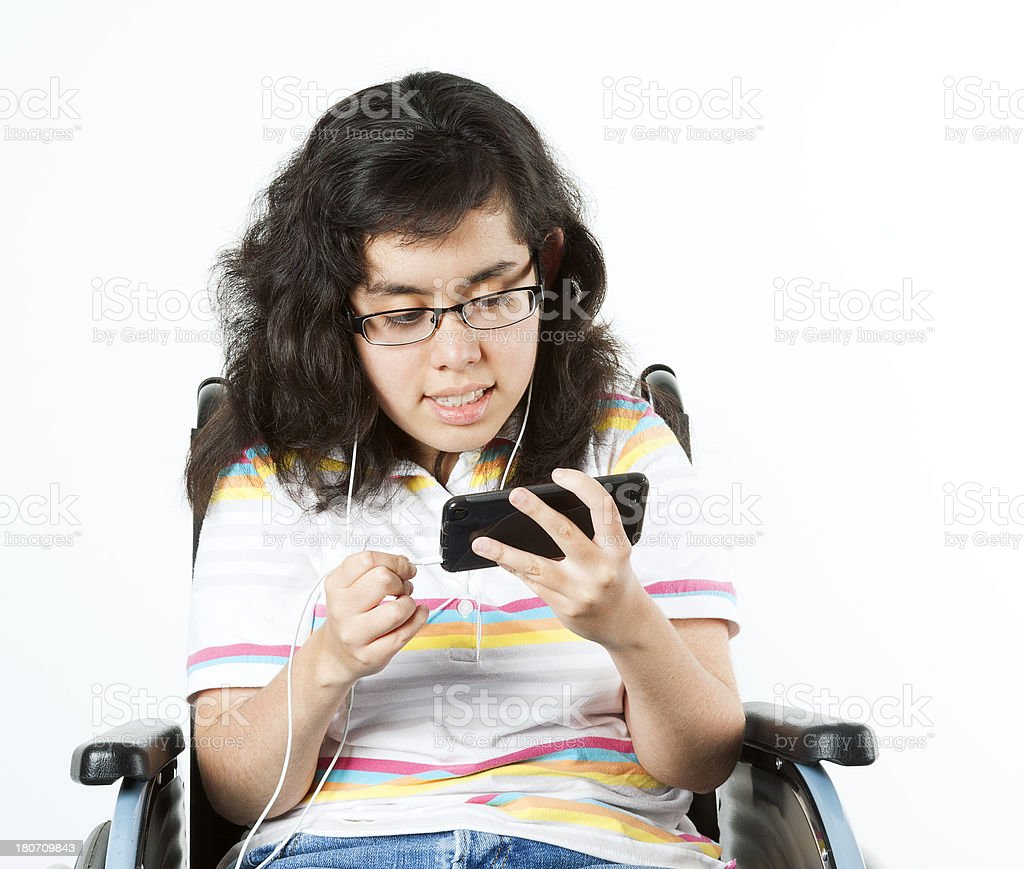 Disabled girl with ipod royalty-free stock photo