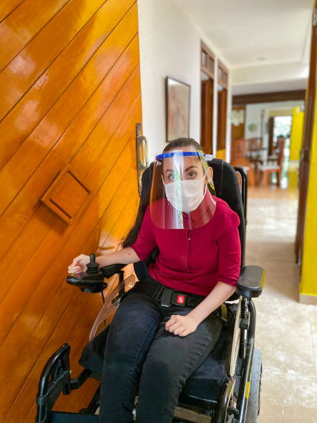 Disabled girl with protective equipment stock photo