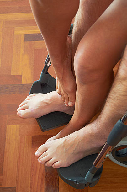 Disabled man and his partner having sex in a wheelchair. stock photo