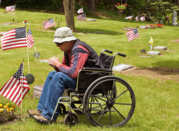 disabled man at the cemetery stock photo