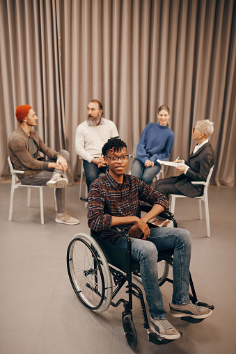 660681964 istock photo Disabled man at therapy lesson 1185686475