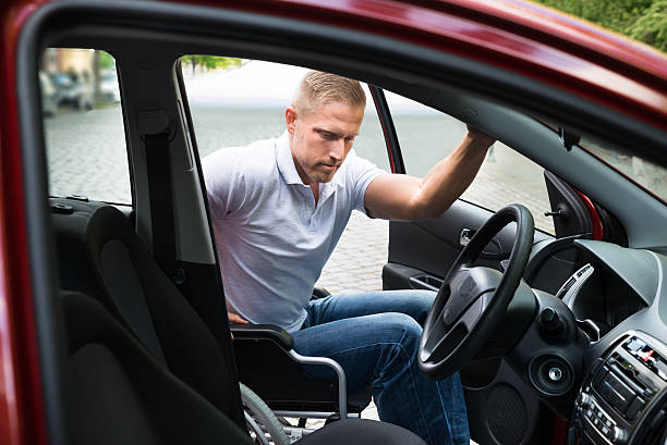 disabled man boarding in his car - impaired driving stock photos and pictures
