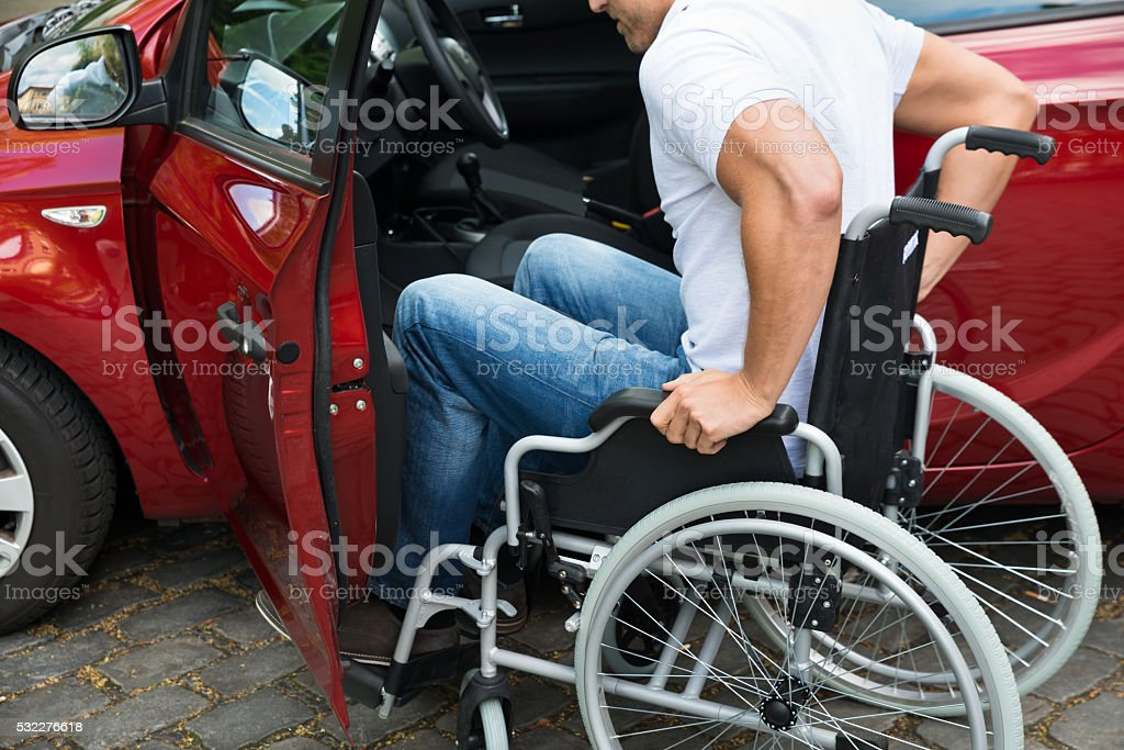 Disabled Man Boarding In His Car stock photo