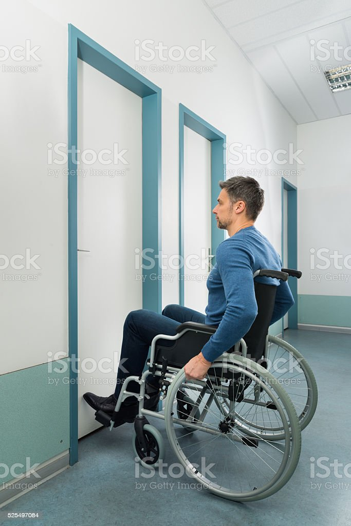Disabled Man Entering In Room stock photo