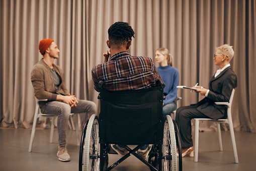 660681964 istock photo Disabled man has a meeting 1185686928