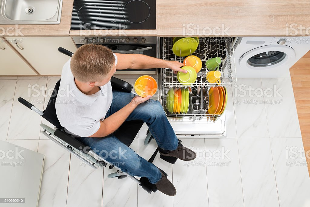 Disabled Man In Kitchen stock photo