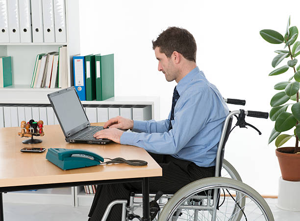 disabled man in the office - contributor stock pictures, royalty-free photos & images