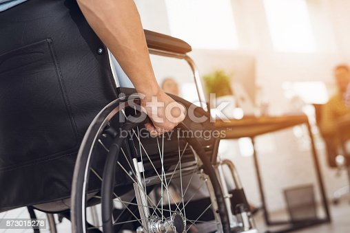 istock A disabled man is sitting in a wheelchair. 873015278