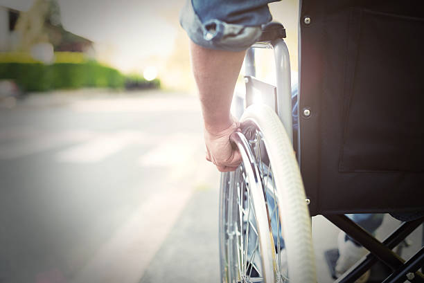 Disabled man on a wheelchair - foto de stock