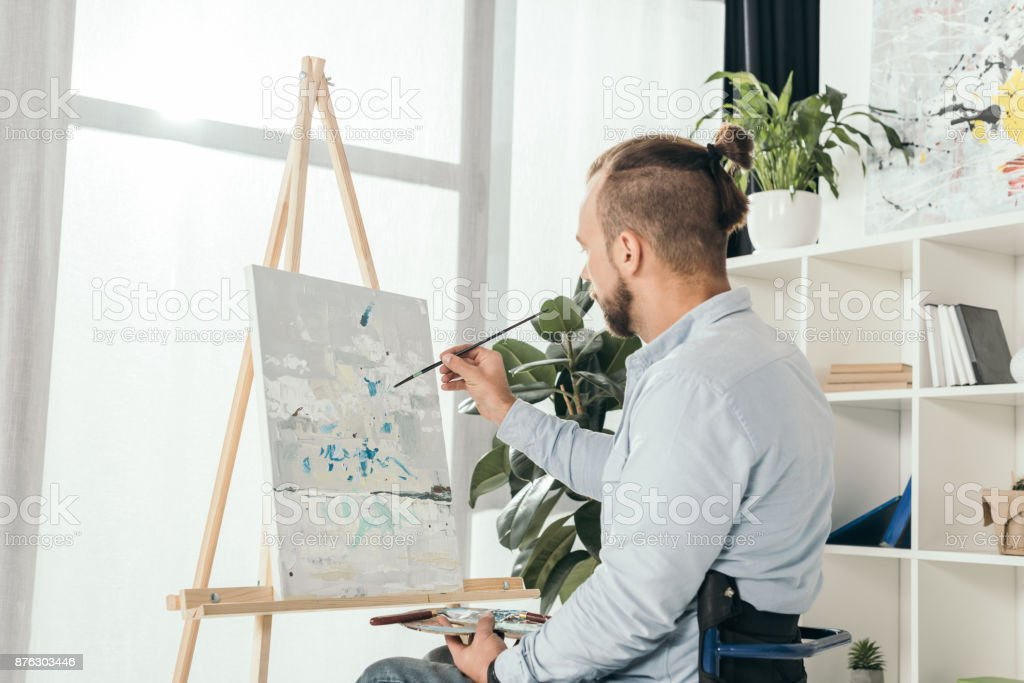 disabled man on wheelchair painting stock photo